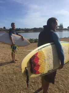 surfing Pataua Bay